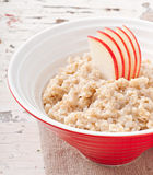 Useful oatmeal with apples Stock Photos
