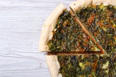 Useful pie with spinach, cheese on wooden table close-up Stock Images