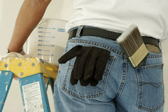 Useful Pockets. Painter's jean pockets filled with supplies Stock Photo