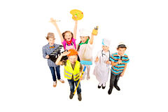 Useful professions. A group of children dressed in costumes of different professions. Isolated over white Stock Images