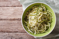 Useful raw zucchini pasta in a bowl close up. horizontal top vie Royalty Free Stock Photos