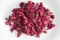 Red beet salad on white plate stock photos
