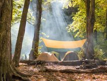 Useful rest in tents in the wild. Rest in the mountains in the fresh air with tents and a fire. Pleasant and useful weekend Stock Photo