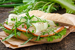 Useful sandwich with ham and herbs Stock Images