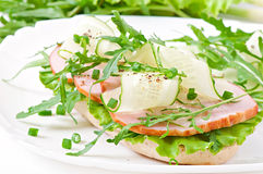 Useful sandwich with ham and herbs Royalty Free Stock Images