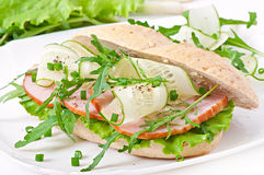 Useful sandwich with ham and herbs Stock Photo