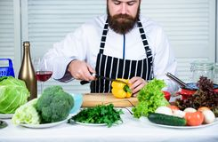 Useful for significant amount of cooking methods. Basic cooking processes. Man master chef or amateur cooking healthy. Food. Chop ingredients. According to royalty free stock images