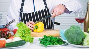 Useful for significant amount of cooking methods. Basic cooking processes. Man master chef or amateur cooking food. Sharp knife chopping vegetable. According royalty free stock image