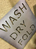 An useful tips for clothes. Wash, dry then fold royalty free stock photography
