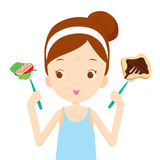 Useful and useless food, choices for girl choosing to eat Royalty Free Stock Image