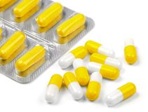 Useful yellow pills on a white background. Useful yellow pills on  white background Royalty Free Stock Photography