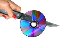 Useless CD. Hand cuttung disk over white Royalty Free Stock Image