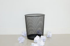 Useless paper outside trash. In the office stock photo