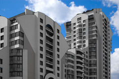 Useless realty. Colourless city multistory house (recent development) on blue sky background Royalty Free Stock Photo