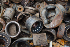 Useless, worn out rusty brake discs shock absorber and other Royalty Free Stock Image