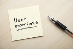 User Experience. Text User Experience written on the sticky note with pen aside royalty free stock photos