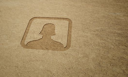 Female Icon. On Sand Background Royalty Free Stock Image