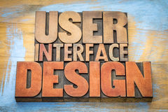User interface design word abstract in letterpress blocks. User interface design  word abstract in letterpress wood type printing blocks stained by color inks Royalty Free Stock Photo