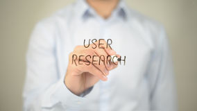 User Research, Man Writing on Transparent Screen Royalty Free Stock Photos