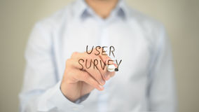 User Survey, Man Writing on Transparent Screen Royalty Free Stock Image