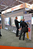 Users discuss new technology at the exhibition, Stock Images