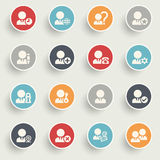 Users icons with color buttons on gray background. Stock Images