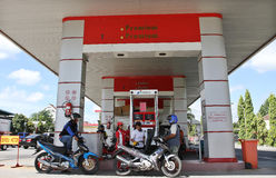 Users motorcycle refuel at one of the filling stations in the ci Stock Photos