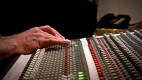 Uses a mixing console in the studio. HD 1080. A recording engineer stock footage
