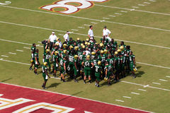 USF Bulls. TALLAHASSEE, FL - SEPTEMBER 26:  University South Florida Bulls gather for coach pep-talk before game against Florida State Seminoles at Doak Campbell Stock Photography