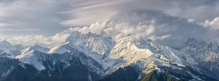 Ushba in clouds. Panoramic view on Ushba in winter Stock Photography