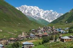 Ushguli in Georgia. Villages community called Ushguli in Upper Svanetia region, Georgia. Shkhara mountain on background Stock Image