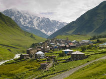 Ushguli village. Dark clouds, summer time caucasus mountain, Ushguli village Royalty Free Stock Photography