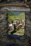 Ushguli village - Georgia. Ushguli village view through a tower window. Ushguli  is a community of villages located at the head of the Enguri gorge in Upper Royalty Free Stock Photo
