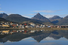 Ushuaia. View on the centre of Ushuaia, Tierra del Fuego, Argentina with reflection in the Beagle Channel royalty free stock photo