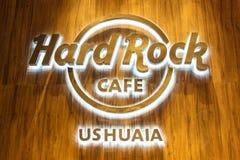 USHUAIA, ARGENTINA - APRIL 8, 2019: Glowing Hard Rock Cafe Ushuaia logo at night. royalty free stock photo