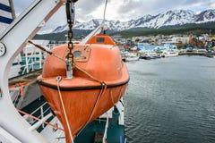 Ushuaia, the capital of Tierra del Fuego, Agenitina. USHUAIA, ARGENTINA - NOV 3, 2012: Boat on a Ship at the Port of Ushuaia, the capital of Tierra del Fuego Royalty Free Stock Photo