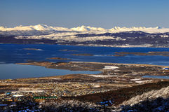 Ushuaia and the Beagle Channel. Ushuaia with the Beagle Channel and snow covered mountains behind it Royalty Free Stock Photos