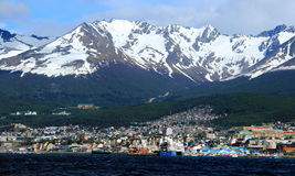 Ushuaia and its mountain backdrop from the Beagle Channel Stock Photo