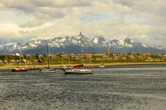 Ushuaia Ship and Mountains. Ushuaia is located in a wide bay on the southern coast of Isla Grande de Tierra del Fuego, bounded on the north by the Martial Royalty Free Stock Photography