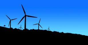 Usine d'énergie éolienne dans le noir bleu de montagnes image libre de droits