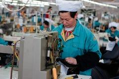 Usine de sueur de Chinois Photographie stock