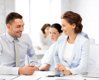 Usiness colleagues talking in office Royalty Free Stock Photos
