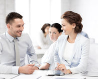 Usiness colleagues talking in office Stock Image
