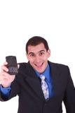Usiness Mann, der einen Handy anhält Lizenzfreies Stockbild