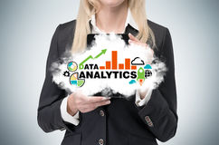 Вusiness woman holds a tablet with cloud and analytical chart. Royalty Free Stock Photos