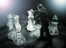 Usinessman on a chessboard as a dummy Royalty Free Stock Photo