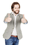 Usinessman looking at camera and showing his thumb up while stan Royalty Free Stock Photos