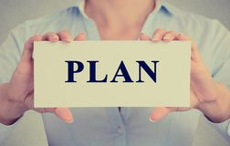 Usinesswoman, female hands holding white sign with message plan Stock Image