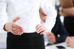 Usinesswoman offer hand to shake hello in office Stock Photography