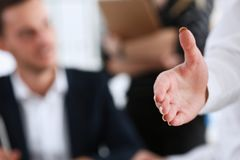 Usinesswoman offer hand to shake hello in office Royalty Free Stock Photos